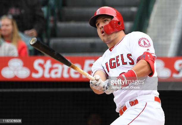 Mike Trout of the Los Angeles Angels of Anaheim hits a RBI double in the seventh inning of the game against the Texas Rangers at Angel Stadium of...