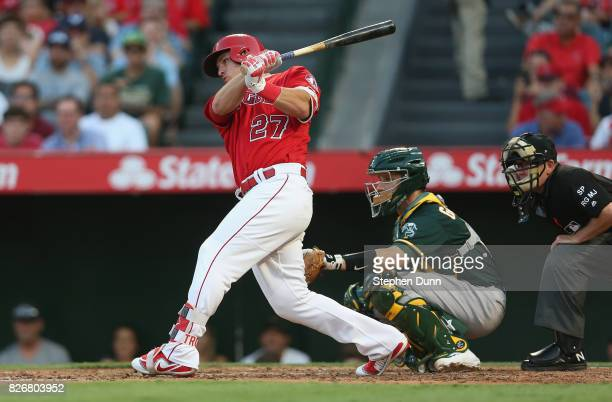 ANAHEIM CALIFORNIA AUGUST Mike Trout of the Los Angeles Angels of Anaheim hits a single in the third inning against the Oakland Athletics at Angel...