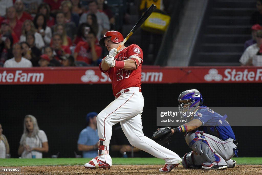 Mike Trout #27 of the Los Angeles Angels of Anaheim hits a single in the fourth inning against the Texas Rangers at Angel Stadium of Anaheim on August 22, 2017 in Anaheim, California.