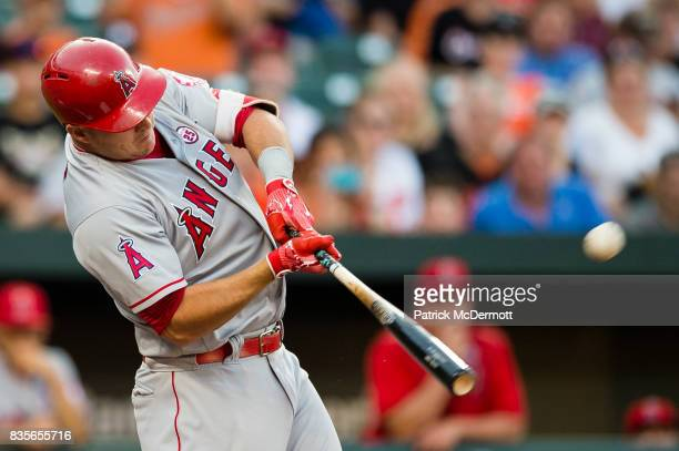 Mike Trout of the Los Angeles Angels of Anaheim hits a solo home run in the first inning during a game against the Baltimore Orioles at Oriole Park...