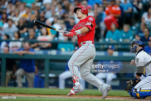 Mike Trout of the Los Angeles Angels of Anaheim hits a threerun home run in the first inning against the Seattle Mariners at Safeco Field on August 5...