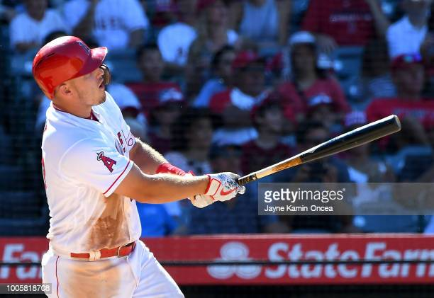 Mike Trout of the Los Angeles Angels of Anaheim hits a two run home run in the seventh inning against the Houston Astros at Angel Stadium on July 22...