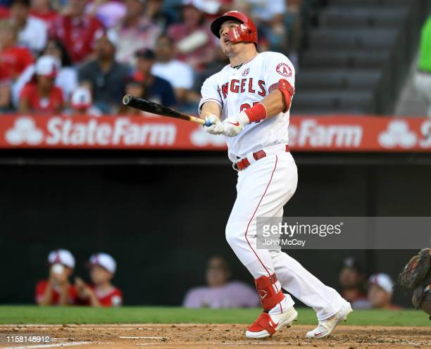 Mike Trout of the Los Angeles Angels of Anaheim hits a two run home run against the Baltimore Orioles in the first inning at Angel Stadium of Anaheim...
