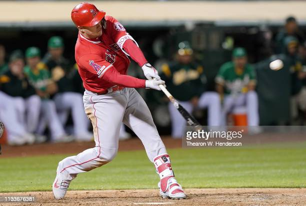 Mike Trout of the Los Angeles Angels of Anaheim hits a two-run rbi double against the Oakland Athletics in the top of the ninth inning of a Major...