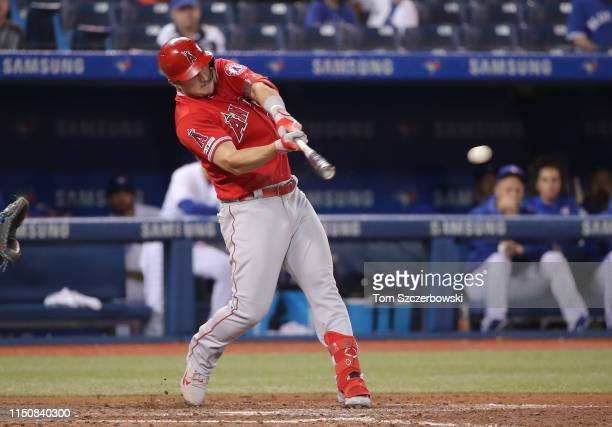 Mike Trout of the Los Angeles Angels of Anaheim hits an RBI single in the ninth inning during MLB game action against the Toronto Blue Jays at Rogers...