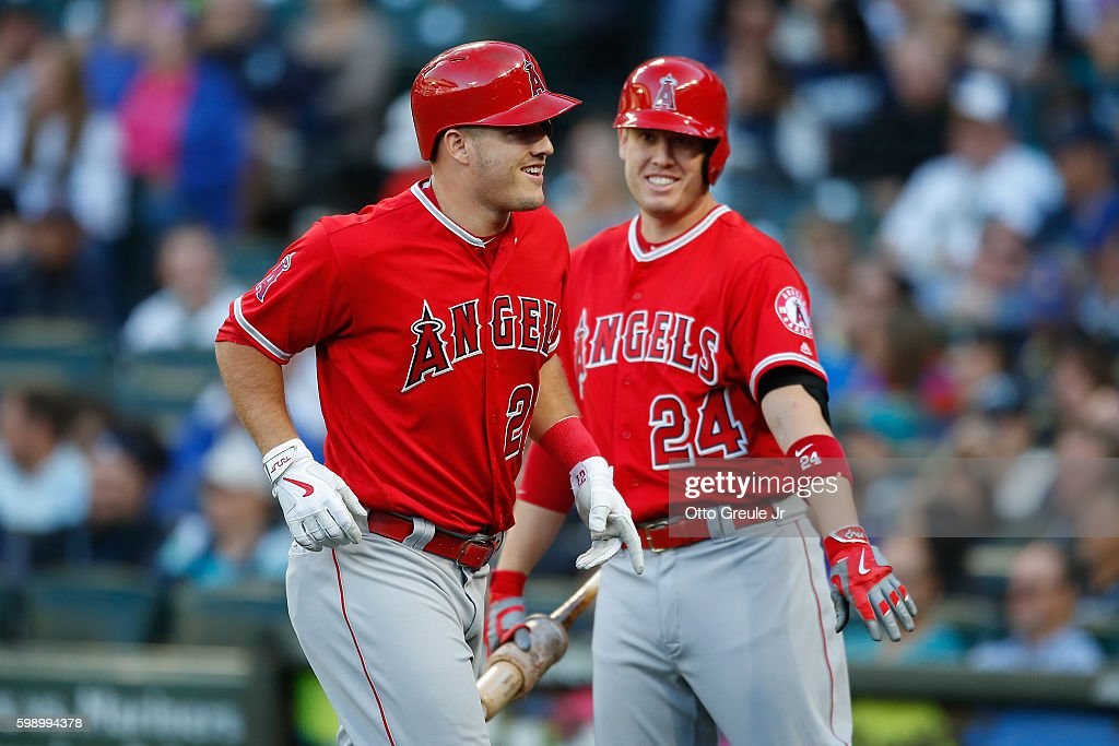 Mike Trout #27 of the Los Angeles Angels of Anaheim is congratulated by C.J. Cron #24 after hitting a solo home run against the Seattle Mariners in the first inning at Safeco Field on September 3, 2016 in Seattle, Washington.