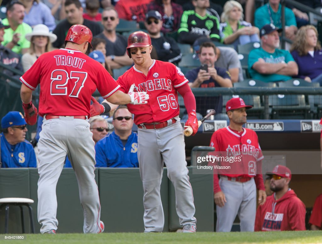 Mike Trout #27 of the Los Angeles Angels of Anaheim is greeted by Kole Calhoun #56 after scoring in the eighth inning against the Seattle Mariners at Safeco Field on September 10, 2017 in Seattle, Washington.