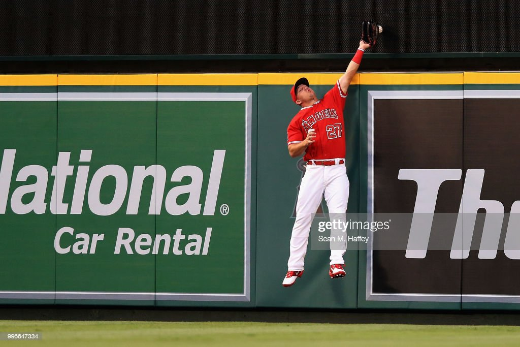 Mike Trout #27 of the Los Angeles Angels of Anaheim is unable to hold onto a solo homerun hit by David Freitas #36 of the Seattle Mariners during the third inning of a game at Angel Stadium on July 11, 2018 in Anaheim, California.