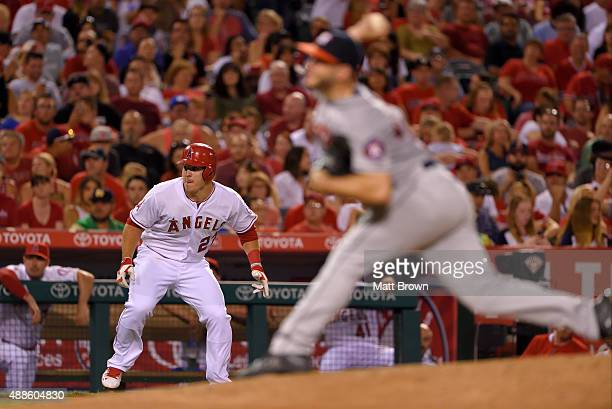 Mike Trout of the Los Angeles Angels of Anaheim leads off third base during the fifth inning of the game against the Houston Astros at Angel Stadium...