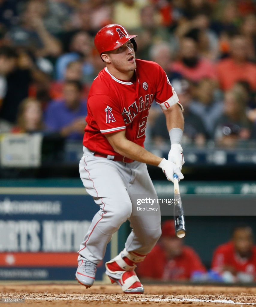 Mike Trout #27 of the Los Angeles Angels of Anaheim lines out to right field in the sixth inning against the Houston Astros at Minute Maid Park on September 22, 2017 in Houston, Texas.