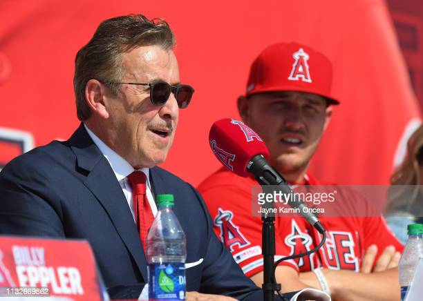 Mike Trout of the Los Angeles Angels of Anaheim looks on as owner Arte Moreno talks during a press conference at Angel Stadium of Anaheim on March 24...