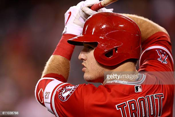 Mike Trout of the Los Angeles Angels of Anaheim looks on from the on deck circle during the first inning of a game against the Oakland Athletics at...