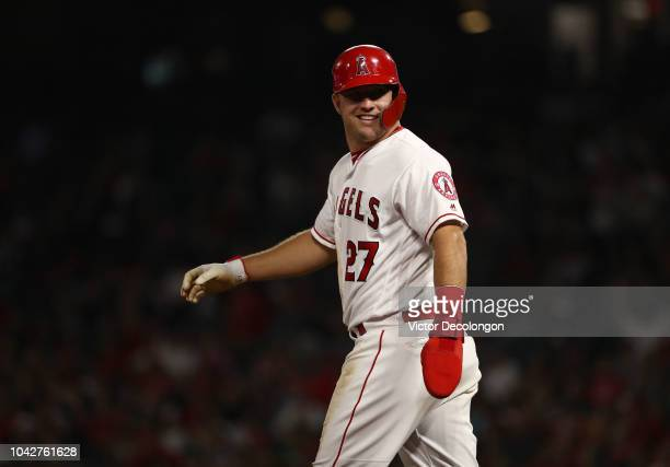 Mike Trout of the Los Angeles Angels of Anaheim looks to the Angels dugout as Trout walks back to second base during the fifth inning of the MLB game...