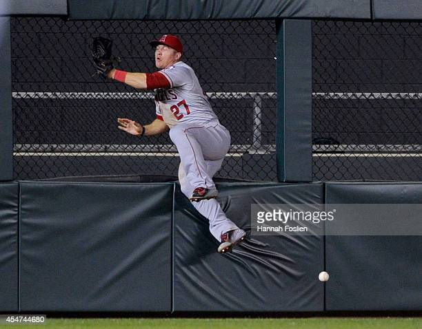 Mike Trout of the Los Angeles Angels of Anaheim misses a catch of a tworun double hit by Trevor Plouffe of the Minnesota Twins during the ninth...