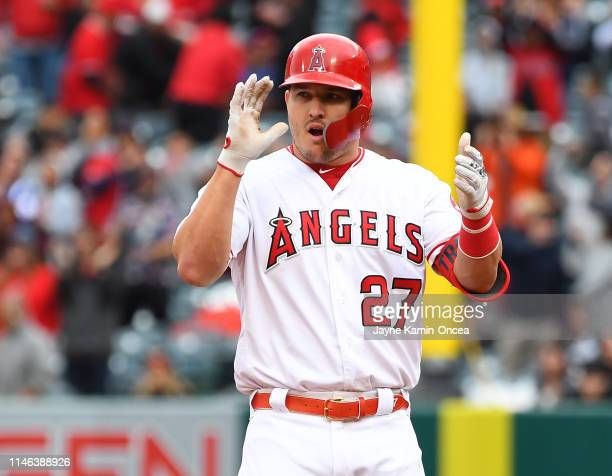 Mike Trout of the Los Angeles Angels of Anaheim on second after hitting a RBI double in the seventh inning of the game against the Texas Rangers at...
