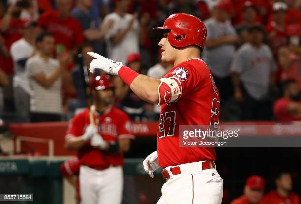 Mike Trout of the Los Angeles Angels of Anaheim points to the stands after hitting a solo homerun during the first inning of the MLB game against the...