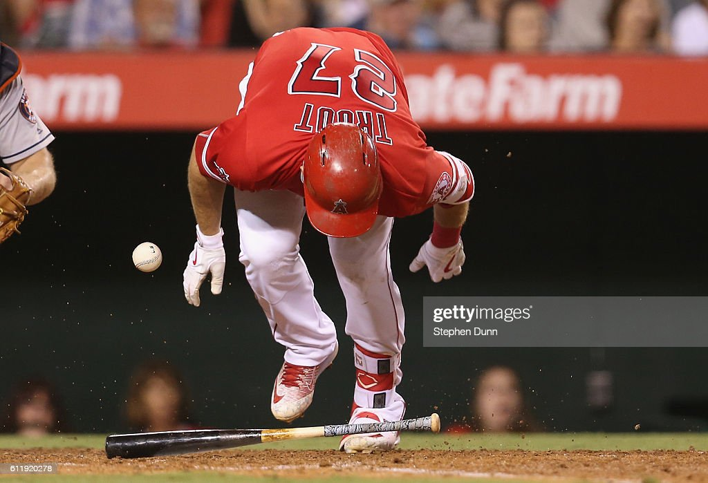 Mike Trout #27 of the Los Angeles Angels of Anaheim reacts after being hit by a pitch in the sixth inning of the game with the Houston Astros at Angel Stadium of Anaheim on October 1, 2016 in Anaheim, California.
