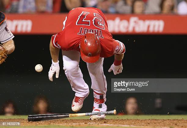 Mike Trout of the Los Angeles Angels of Anaheim reacts after being hit by a pitch in the sixth inning of the game with the Houston Astros at Angel...