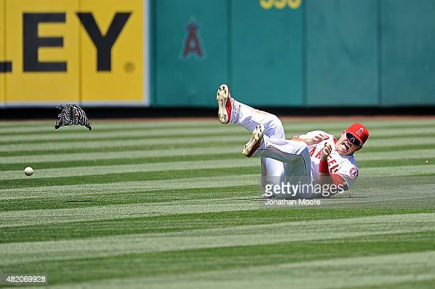 Mike Trout of the Los Angeles Angels of Anaheim reacts after landing on his hand diving for a fly ball in the fourth inning during a game against the...