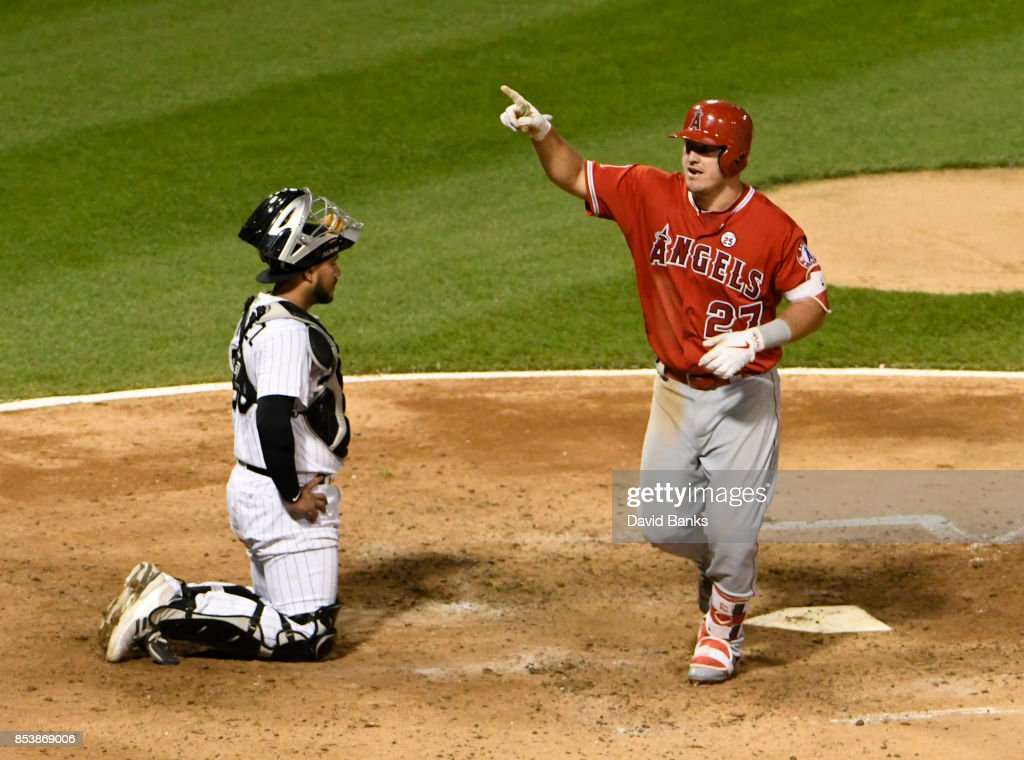 Mike Trout #27 of the Los Angeles Angels of Anaheim reacts as he crosses home plate after hitting a home run as Omar Narvaez #38 of the Chicago White Sox watches during the fifth inning on September 25, 2017 at Guaranteed Rate Field in Chicago, Illinois.