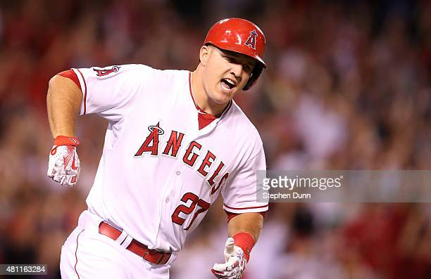 Mike Trout of the Los Angeles Angels of Anaheim reacts as he runs to first as his walk off home run clears the wall in the ninth inning against the...