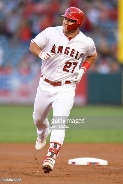 Mike Trout of the Los Angeles Angels of Anaheim rounds second base after hitting a first inning home run against the Seattle Mariners at Angel...