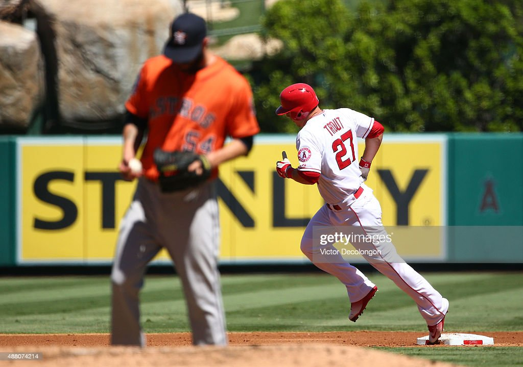 Mike Trout #27 of the Los Angeles Angels of Anaheim rounds second base after hitting a solo homerun against pitcher Mike Fiers #54 of the Houston Astros in the first inning during the MLB game at Angel Stadium of Anaheim on September 13, 2015 in Anaheim, California.