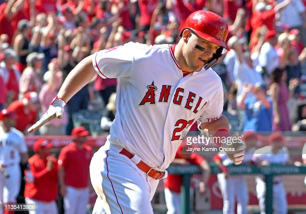 Mike Trout of the Los Angeles Angels of Anaheim rounds the bases after hitting a grand slam home run in the fourth inning of the game against the...