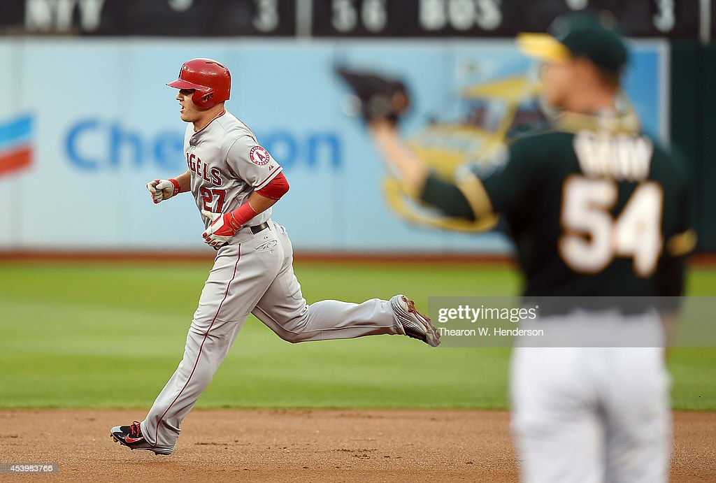 Mike Trout #27 of the Los Angeles Angels of Anaheim runs the bases after hitting a solo home run off Sonny Gray #54 of the Oakland Athletics in the top of the first inning at O.co Coliseum on August 22, 2014 in Oakland, California.