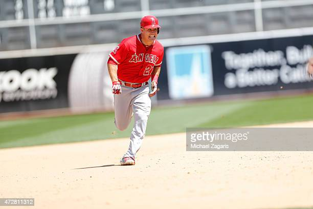 Mike Trout of the Los Angeles Angels of Anaheim runs the bases during the game against the Oakland Athletics at Oco Coliseum on April 30 2015 in...