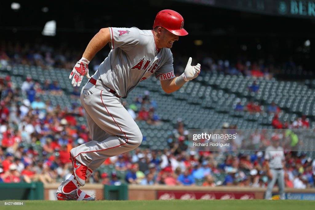 Mike Trout #27 of the Los Angeles Angels of Anaheim runs to first base during a game against the Texas Rangers at Globe Life Park in Arlington on September 3, 2017 in Arlington, Texas.