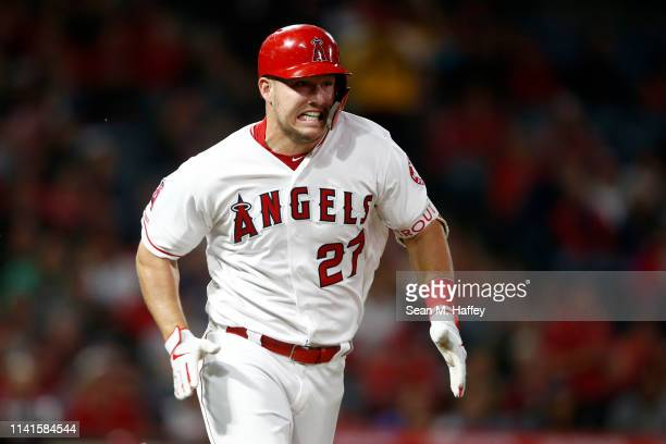 Mike Trout of the Los Angeles Angels of Anaheim runs to first base after hitting a single during the second inning of a game against the Milwaukee...