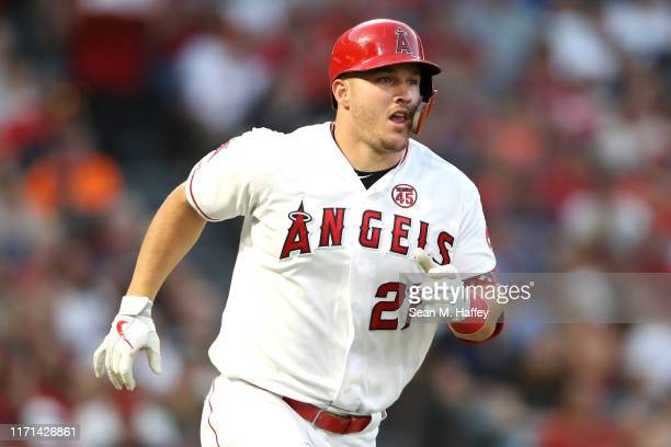 Mike Trout of the Los Angeles Angels of Anaheim runs to first base after hitting an RBI single during the second inning of a game against the Boston...