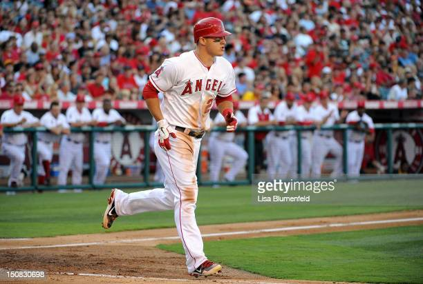Mike Trout of the Los Angeles Angels of Anaheim runs to first base against the Texas Rangers at Angel Stadium of Anaheim on July 22 2012 in Anaheim...