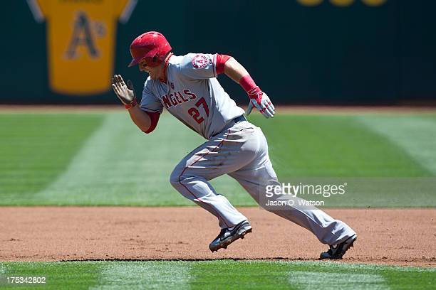 Mike Trout of the Los Angeles Angels of Anaheim runs to second base against the Oakland Athletics in the first inning at Oco Coliseum on July 28 2013...