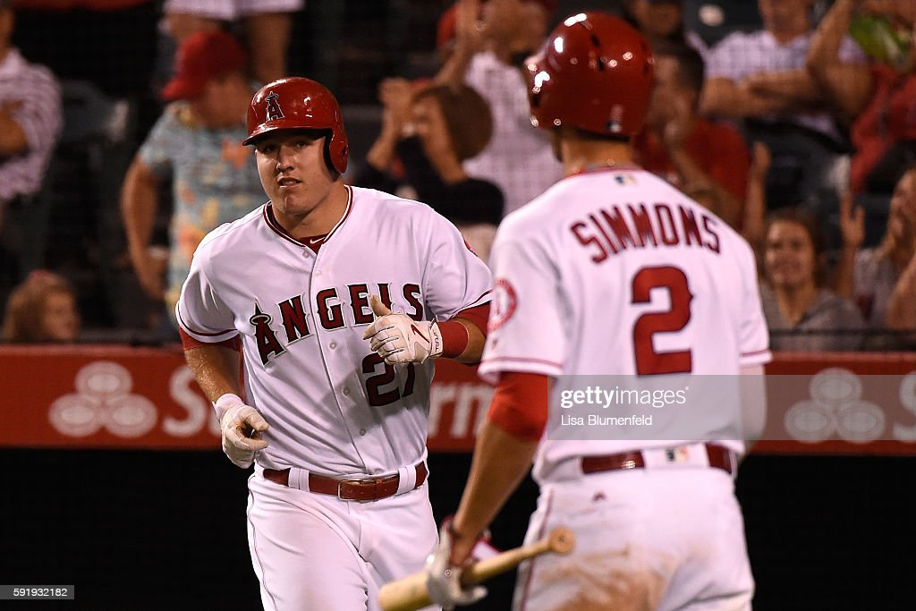 Mike Trout #27 of the Los Angeles Angels of Anaheim scores in the eighth inning against the Seattle Mariners at Angel Stadium of Anaheim on August 18, 2016 in Anaheim, California.
