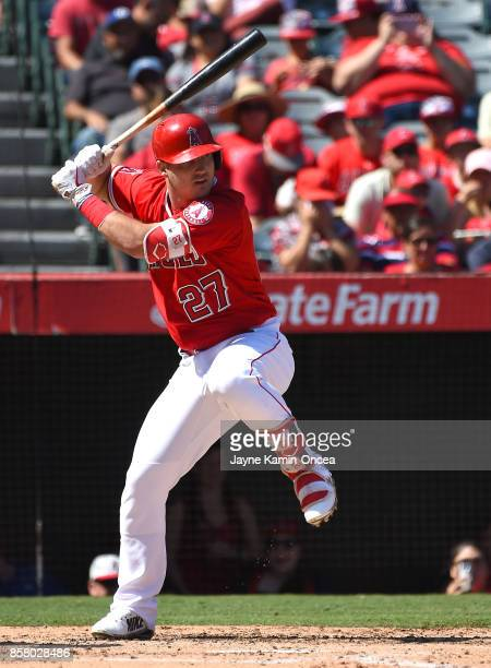 Mike Trout of the Los Angeles Angels of Anaheim singles in his last at bat of the season in the third inning of the game against the Seattle Mariners...