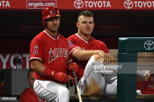 Mike Trout of the Los Angeles Angels of Anaheim sits in the dugout during the game against the Los Angeles Dodgers at Angel Stadium of Anaheim on...