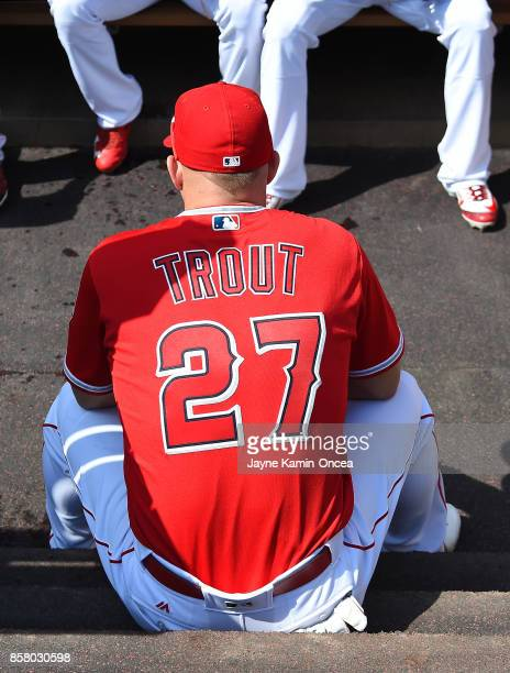 Mike Trout of the Los Angeles Angels of Anaheim sits on the dugout steps before the start of the game against the Seattle Mariners at Angel Stadium...