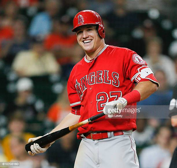 Mike Trout of the Los Angeles Angels of Anaheim smiles over at the Houston Astros dugout after a foul ball was hit that way at Minute Maid Park on...