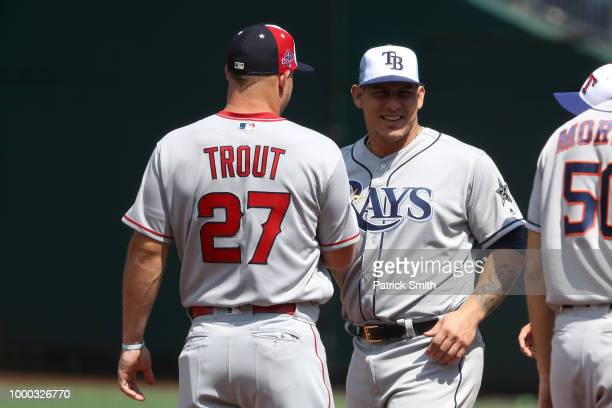 Mike Trout of the Los Angeles Angels of Anaheim speaks to Wilson Ramos of the Tampa Bay Rays during the American League AllStars workout during...