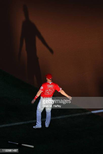 Mike Trout of the Los Angeles Angels of Anaheim stretches prior to a game against the Oakland Athletics at Angel Stadium of Anaheim on June 05, 2019...