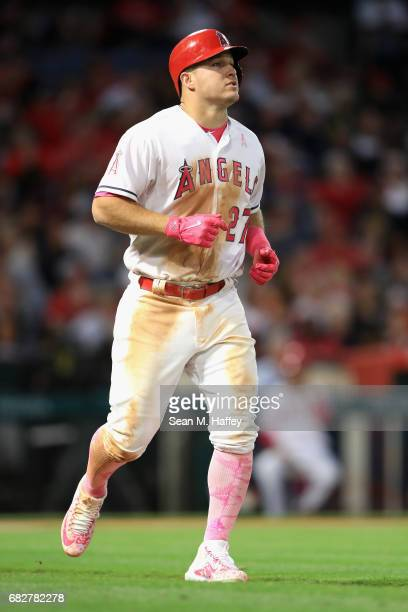 Mike Trout of the Los Angeles Angels of Anaheim walks to first base after being hit by a pitch during the fifth inning of a game against the Detroit...