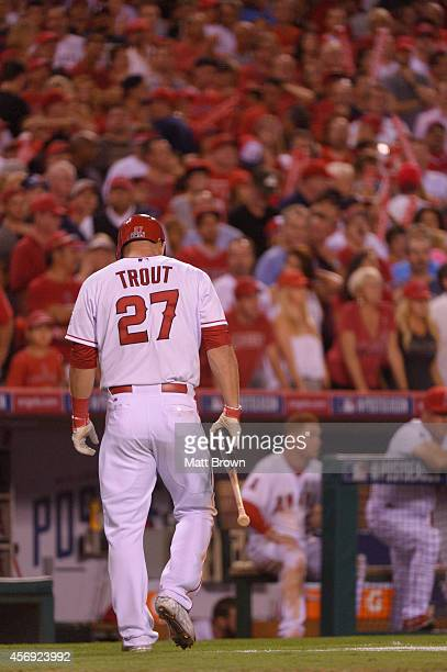 Mike Trout of the Los Angeles Angels of Anaheim walks towards the dugout against the Kansas City Royals during Game 2 of the American League Division...