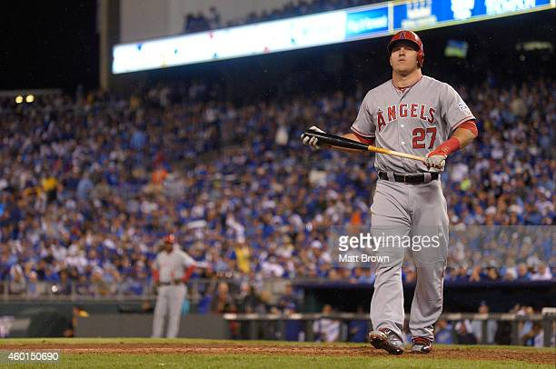 Mike Trout of the Los Angeles Angels of Anaheim walks towards the dugout after striking out during game 3 of the American League Division Series...