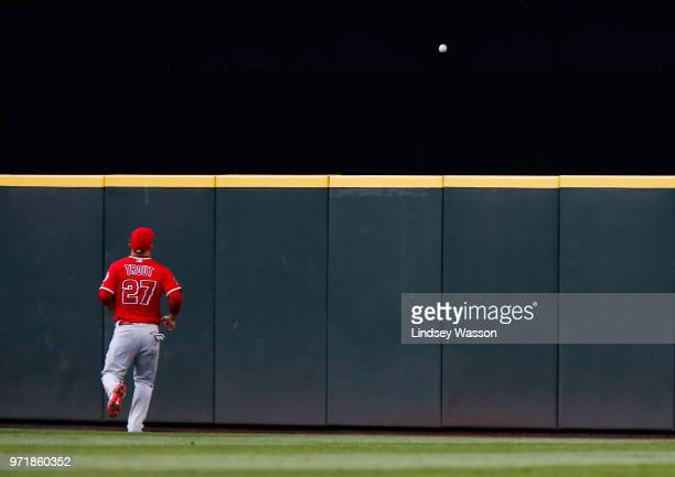 Mike Trout of the Los Angeles Angels of Anaheim watches the home run ball clear the fence in the fourth inning during the game at Safeco Field on...