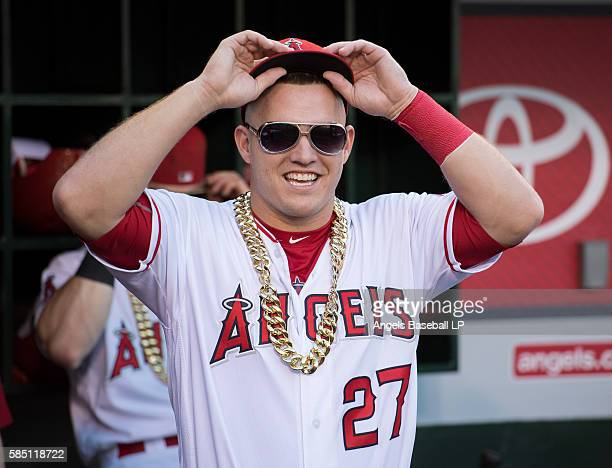 Mike Trout of the Los Angeles Angels of Anaheim wears sunglasses and a golden chain that resemble those worn by David Ortiz of the Boston Red Sox...