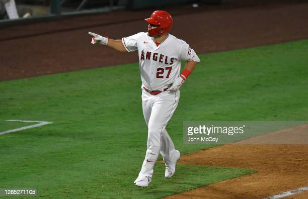 Mike Trout of the Los Angeles Angels points to the bench after he hit what would become the game winning home run in the eight inning against the...