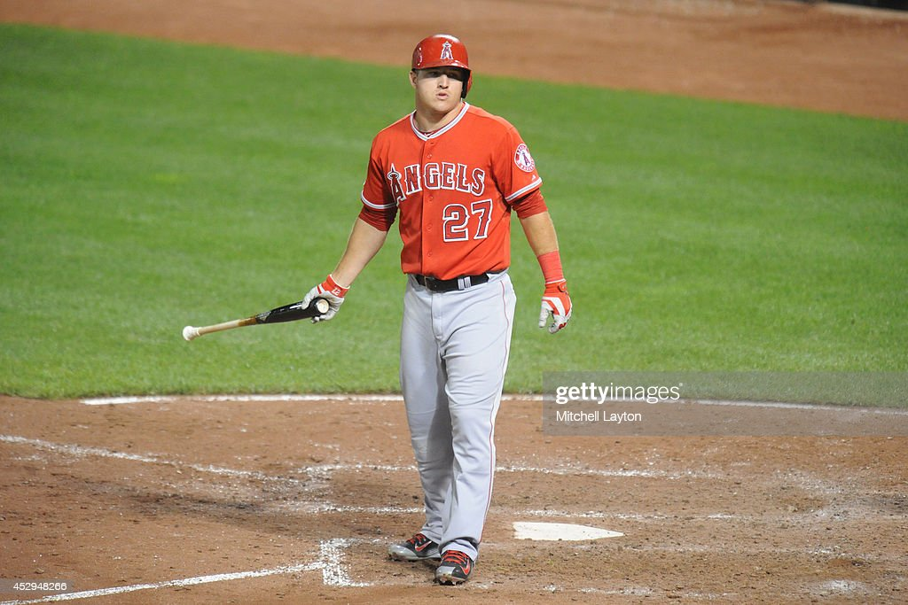 Mike Trout #27 of the Los Angeles Angels reacts after striking out for in the eighth inning during a baseball game against the Los Angeles Angels of Anaheim on July 30, 2014 at Oriole Park at Camden Yards in Baltimore, Maryland. The Orioles won 4-3.