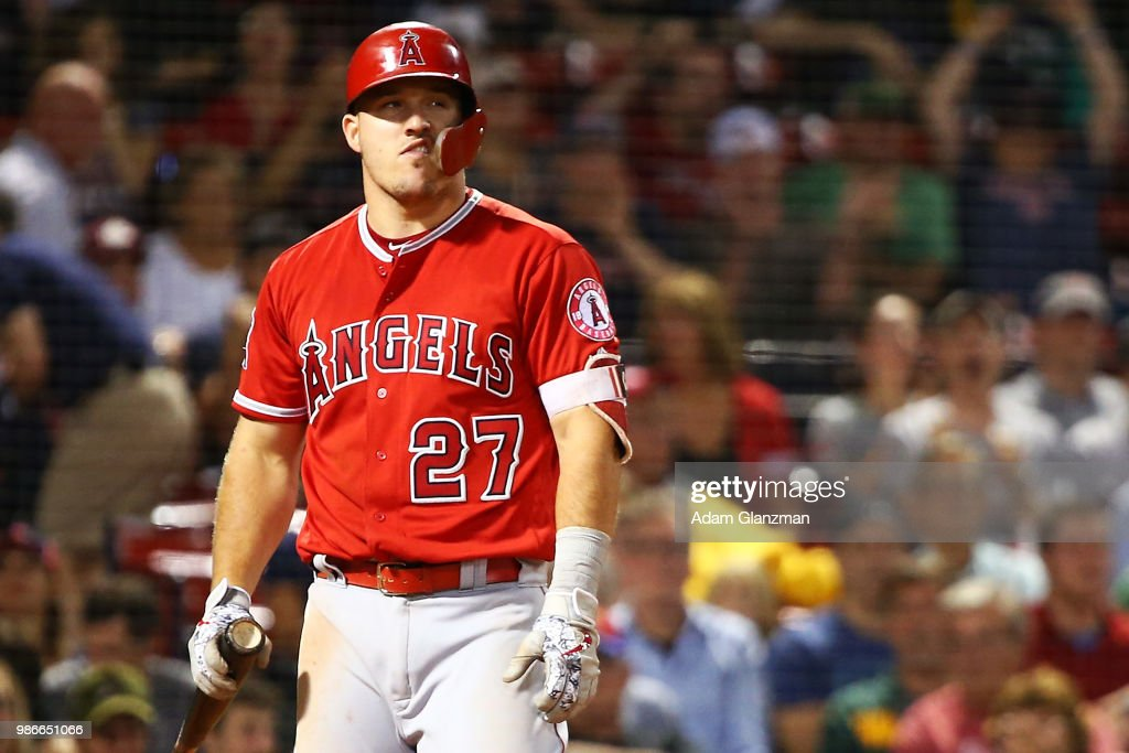 Mike Trout #27 of the Los Angeles Angels reacts after striking out in the ninth inning of a game against the Boston Red Sox at Fenway Park on June 28, 2018 in Boston, Massachusetts.